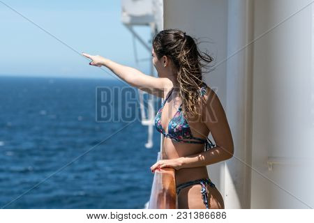 Woman Pointing to the Sea From Cruise Ship