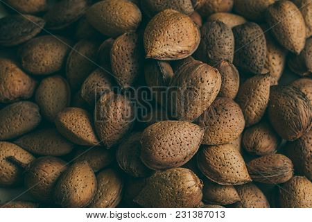 Shelled Almonds Texture And Background. Heap Of Shelled Almonds. Macro Shot Of Almonds Texture And B