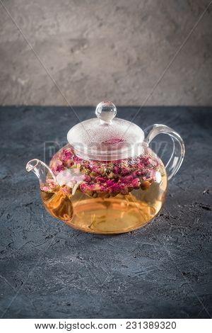 Teapot With Detox Drink From Flower Buds Dry Red Pink Rose Tea With Drops Of Condensate From Hot Wat