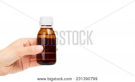 Syrup Mixture In Glass Bottle In Hand. Isolated On White Background. Copy Space, Template.