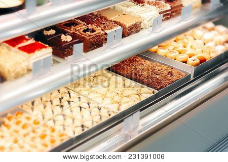 Cake Desserts In Showcase Window In Confectionery Store