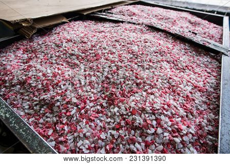 Plastic Colored Granulated Crumb At The Plant For Processing And Casting Products From Domestic And