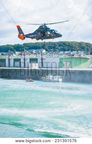 Fecamp-france, September 16,2017 - Non Foucus Scene Helicopter In Flight Ready To Rescue A Man With