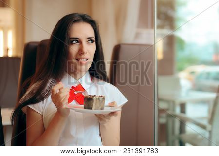 Woman Eating Chocolate Souffle in a Confectionery Shop