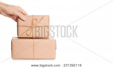 Eco Gift Box From Kraft Paper In Hand Isolated On White Background. Copy Space, Template.
