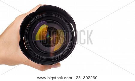 Camera Lens In Hand Isolated On White Background. Copy Space, Template.
