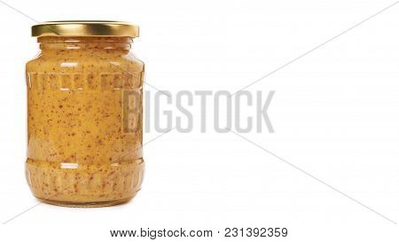 Home Made Mustard In Glass Bottle Isolated On White Background. Copy Space, Template.