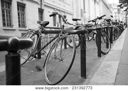 A Bunch Of Bikes Tightened On Racks On The Street Of Paris, France.
