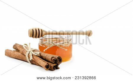 Honey Pot Cinnamon On An Isolated White Background, Rope. Copy Space, Template