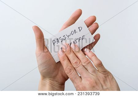 Woman's Hand Holds A Password On Paper, That Covers The Password With Finger