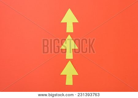 Arrows Only Forward. Three Arrows In One Direction. Orange Background And Bright Yellow Arrows
