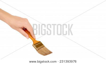 Orange Paint Brush In Hand Isolated On White Background. Copy Space, Template.