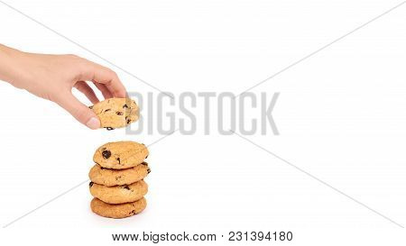 Pile Of Chocolate Chip Cookies In Hand Isolated On White Background. Copy Space, Template.