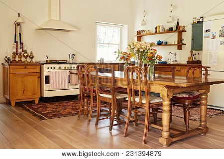Interior Of The Country Style Kitchen And Dining Table In A Large Residential Home