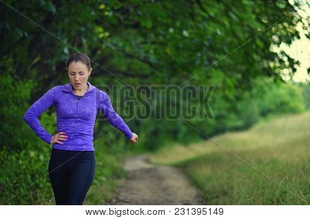 Tired Young Girl On A Run In The Forest.