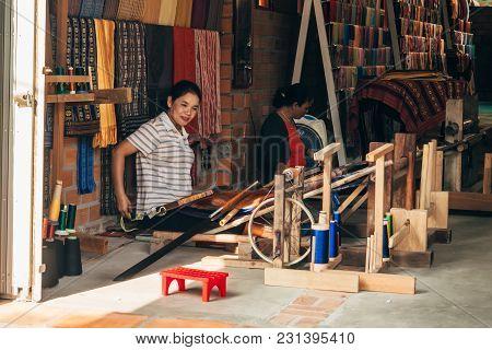 Mui Ne, Vietnam - March 6, 2017: Women Weavers Work Traditional Looms For Silk In The Workshop