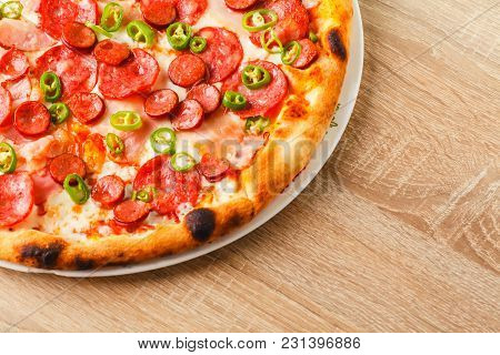 Pizza Close Up On A Wooden Table