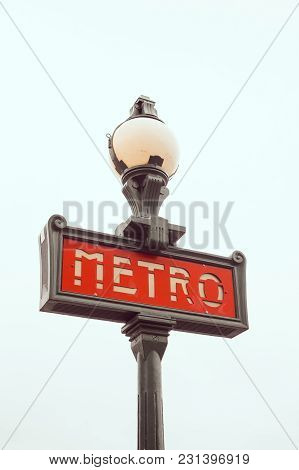 Traditional Paris Metro Sign Against A Clear White Sky