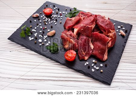Fresh Lamb Meat On A Textured Stone Plate.