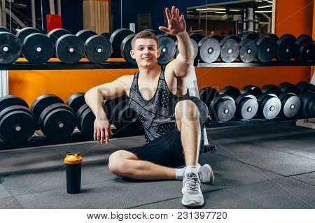 Happy Attractive Man Resting After A Workout At The Gym