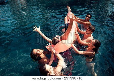 Company Of Friends Carefree Spend Time Swimming In Pool. Swimming Pool Party Concept. Guys And Girls