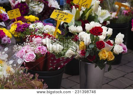 Flowers in a florist shop outdoors floor ready to be sold with a variety of pots with plants and pri