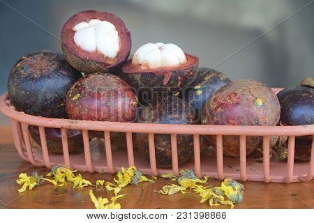 Garcinia Mangostana Or Called Manggis In Indonesia. Tropical Mangosteen Fruits Presented In A Basket