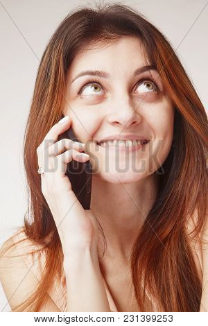 Beautiful Happy Lovely Woman Laughs, Smiles And Speaks On Mobile Phone. Love And Positive Emotion Co