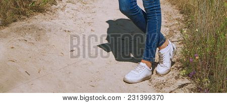 Summer Trips. Young Woman Standing On A  Mountain Road  And Is Ready For Summer Vacation And Travel