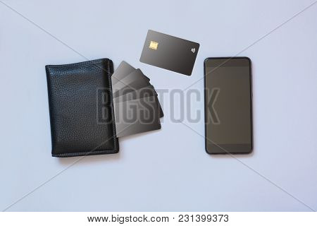 Business Concept. Storing Information About Credit Cards In A Mobile Application. Mobile And Wallet
