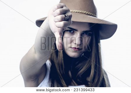 Everything Is Bad. Woman Showing Her Thumb Finger Down As Symbol Of Frustration, Depression, Difficu