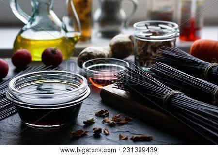 Black Rice Vermicelli, Vinegar, Olive Oil And Vegetables. Asian Cuisine Horizontal