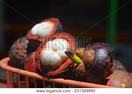 Garcinia Mangostana. Sweet Tropical Mangosteens Fruits Called