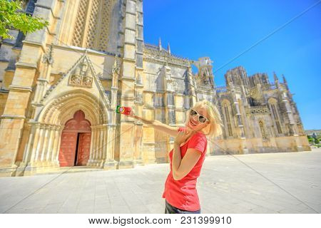 Happy Woman Takes Photo Of Batalha Monastery One Of The Most Important Gothic Sites In Portugal. Fem