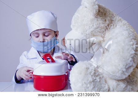 Little Child Girl Playing Doctor With Teddy Bear (health, Medicine, Hospital Concept)