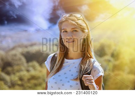 Happy Young Woman With Backpack Standing On Top Of Mountain And Enjoying Valley View. (travel, Natur