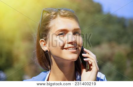 Portrait Of Pretty Happy Lovely Young Woman Speaking On Mobile Phone. Love And Positive Emotion Conc