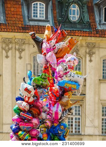 Warsaw, Poland - June 29, 2013: Colorful Balloons Against The Background Of Ancient Buildings. Marke