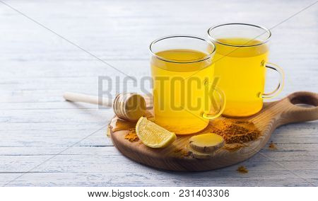 Energy Tonic Drink With Turmeric, Ginger, Lemon And Honey On A Wooden Board, Free Space, Selective F