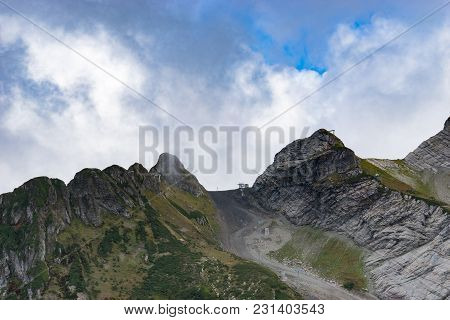 Sochi, Russia-september 30, 2017: Mountain Landscape With Rocky Slopes And The Cable Car In Krasnaya