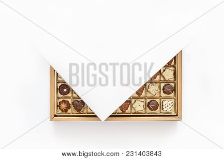 An Assortment Of Expensive Chocolates In A White Open Box