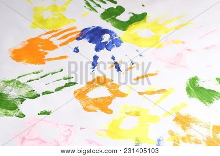 Children's Creativity Prints Of Hands Of Different Colors On White Paper, Lots Of Imprint Of Hands