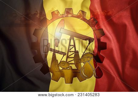 Oil Rig Against The Background Of The Flag Of Belgium. Mixed Environment. The Concept Of Oil Product