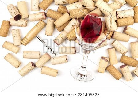 An Overhead Photo Of A Glass Of Red Wine With Corks And A Corkscrew On A White Background. A Wine Ta