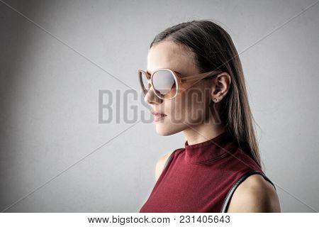 Wearing fashionable sunglasses