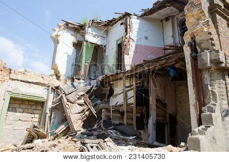 Concept Of The Fighting Force And War. Abandoned And Devastated Building In Ukraine, Donbass. Ukrain