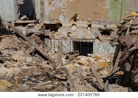 Concept Of The Fighting Force And War. Abandoned And Devastated Building In Ukraine, Donbass