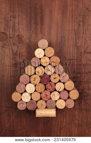 A Christmas Tree Made Of Wine Corks On A Dark Rustic Wooden Background With A Place For Text. A New