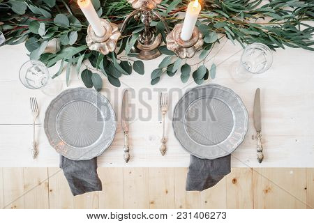 Decoration Of Wedding Table In Rustic Style. Eucalyptus And Flowers On The Table