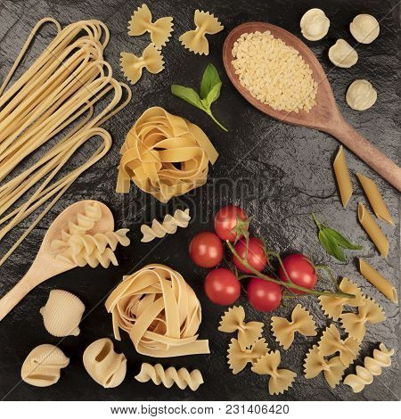 An Overhead Square Photo Of Different Types Of Pasta, Including Spaghetti, Penne, Fusilli, And Other
